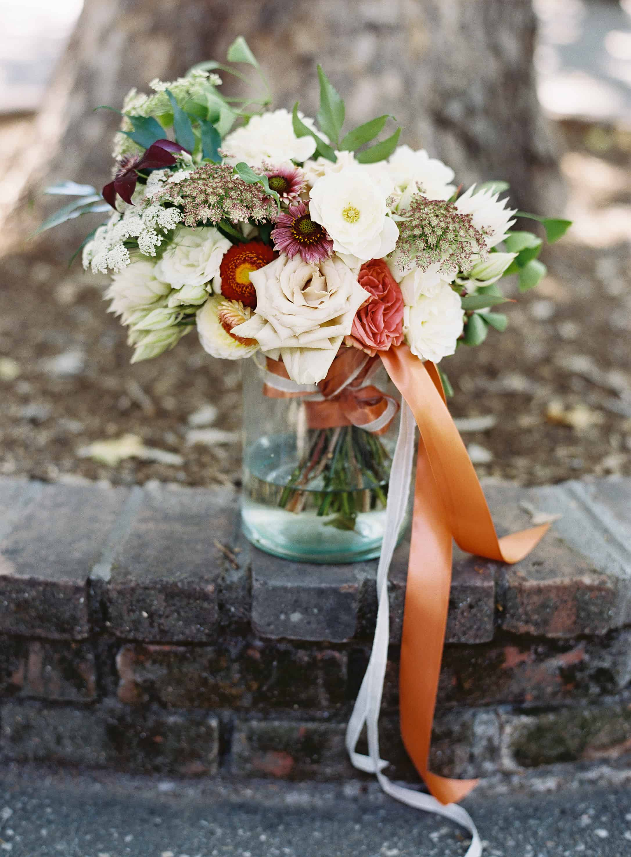 orange red white bouquet flowers
