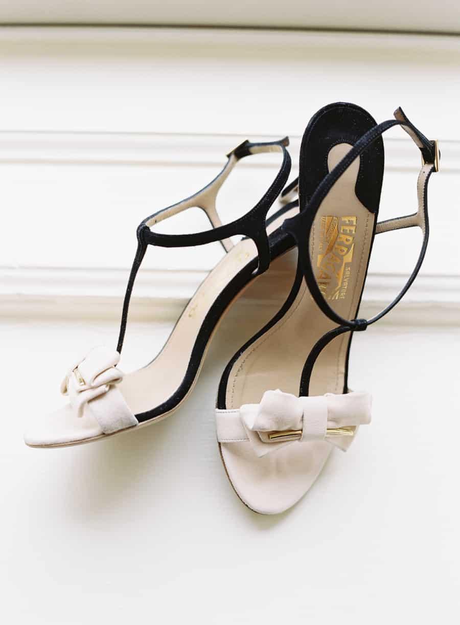 detail shot of white and black ferragamo shoes