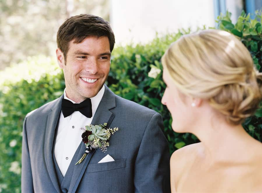 couples portrait groom looking at bride