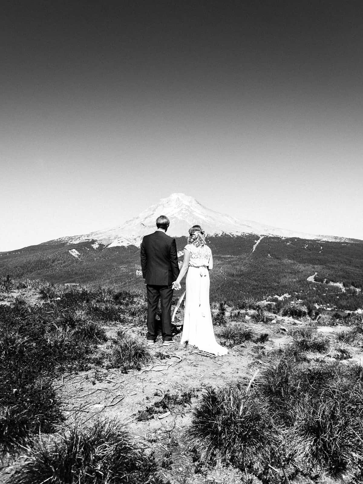 bride and groom looking at mt hood in black and white