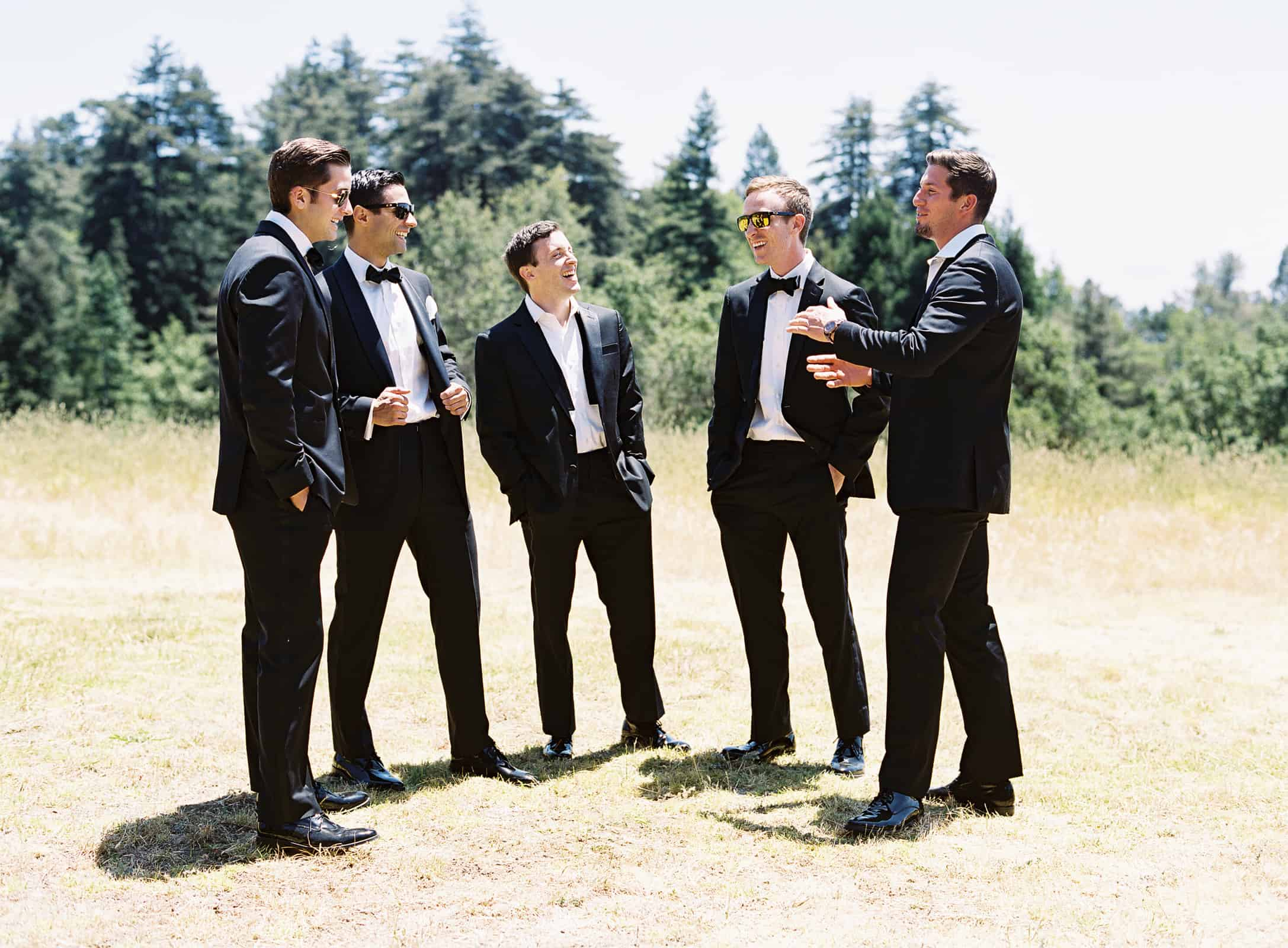 groom standing and laughing with groomsmen