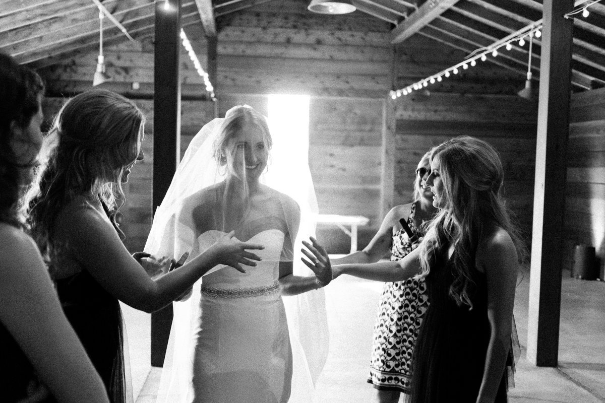 bride getting ready in barn