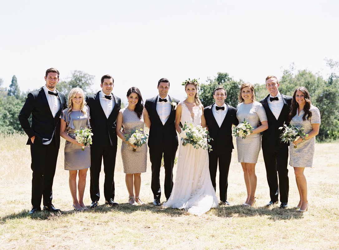 wedding party in black tie tuxedos and silver dresses