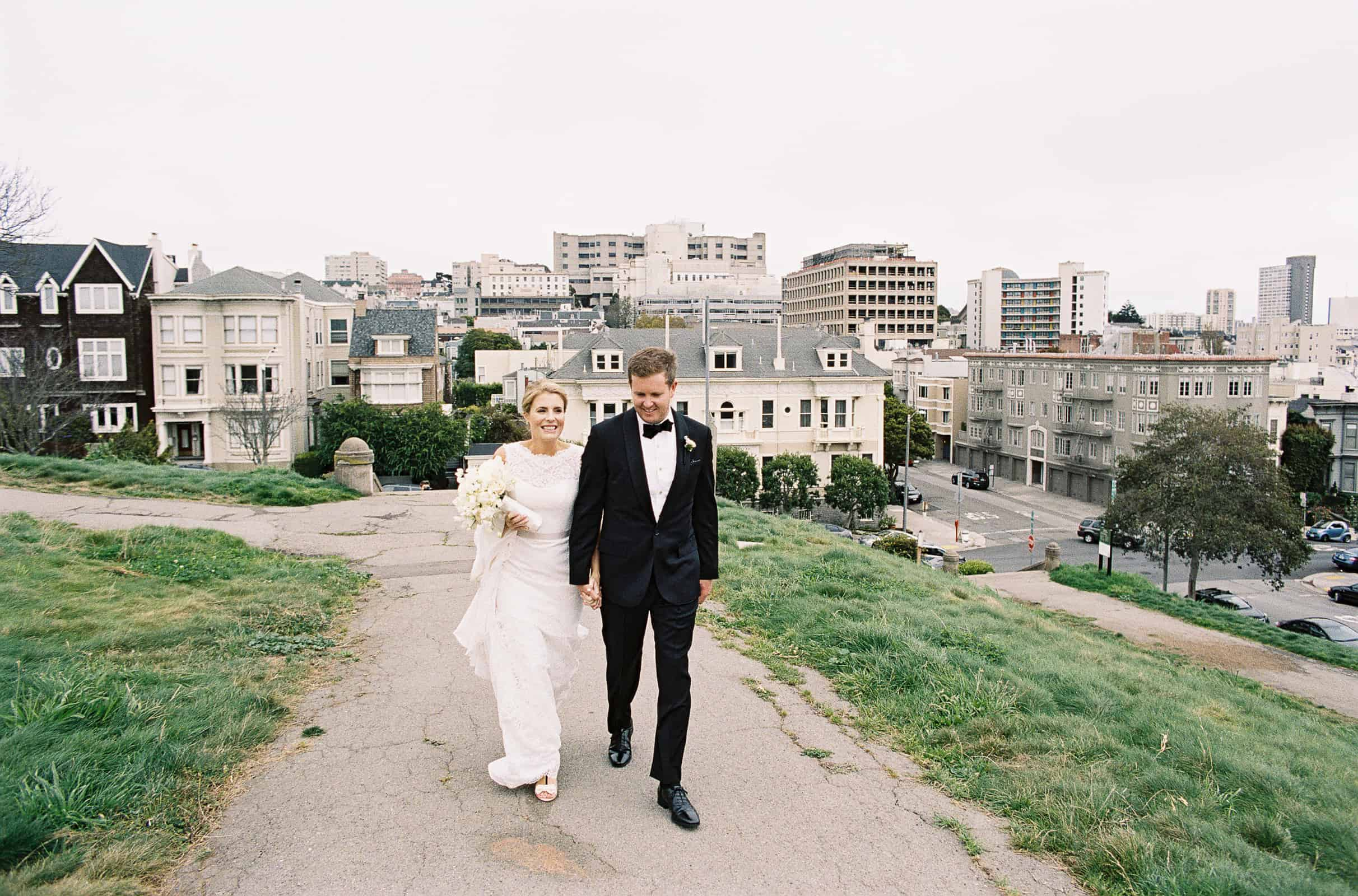 bride and groom with san francisco background