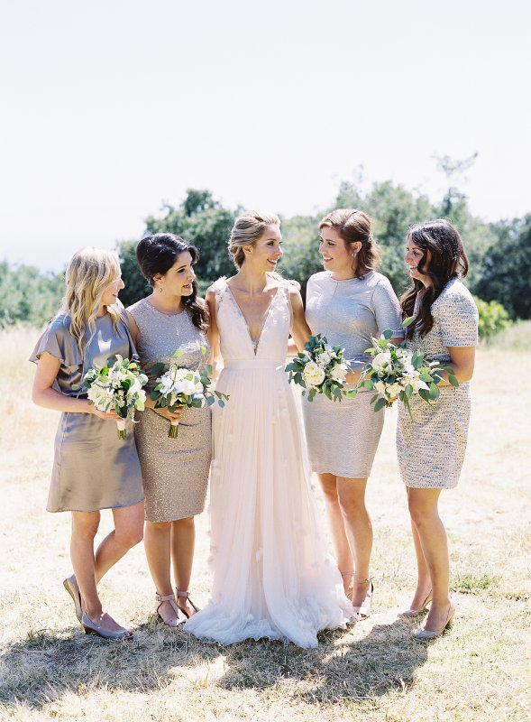 bride with bridesmaids in silver dresses