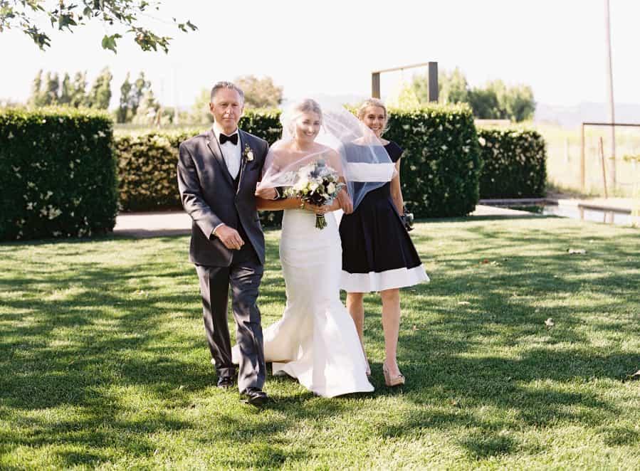 ceremony bride entrance with parents
