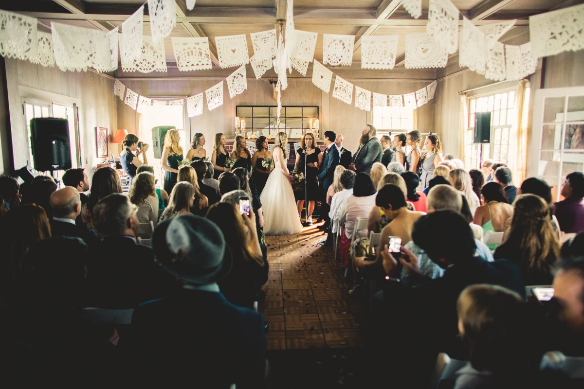 indoor ceremony with papel picado banners