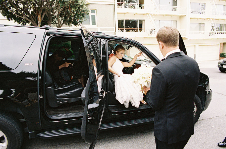 bride getting out of black suv