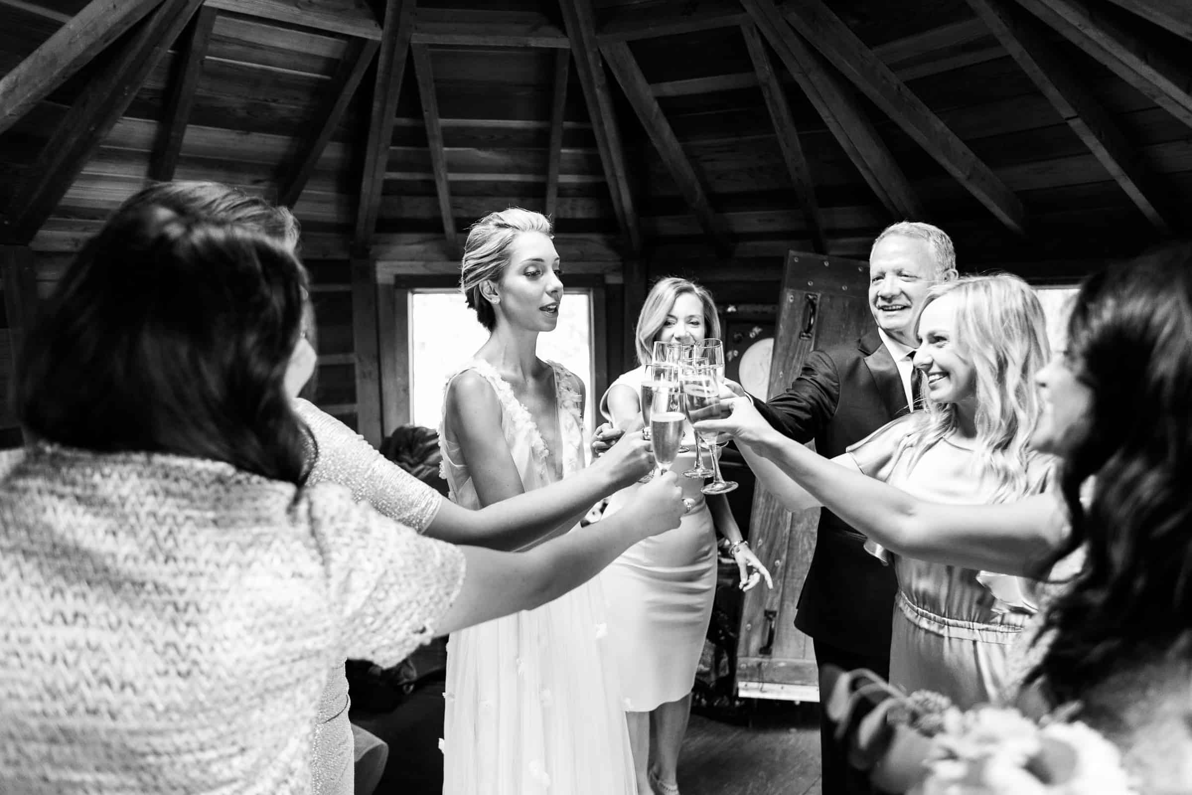 bride's family doing a champagne toast in a yurt