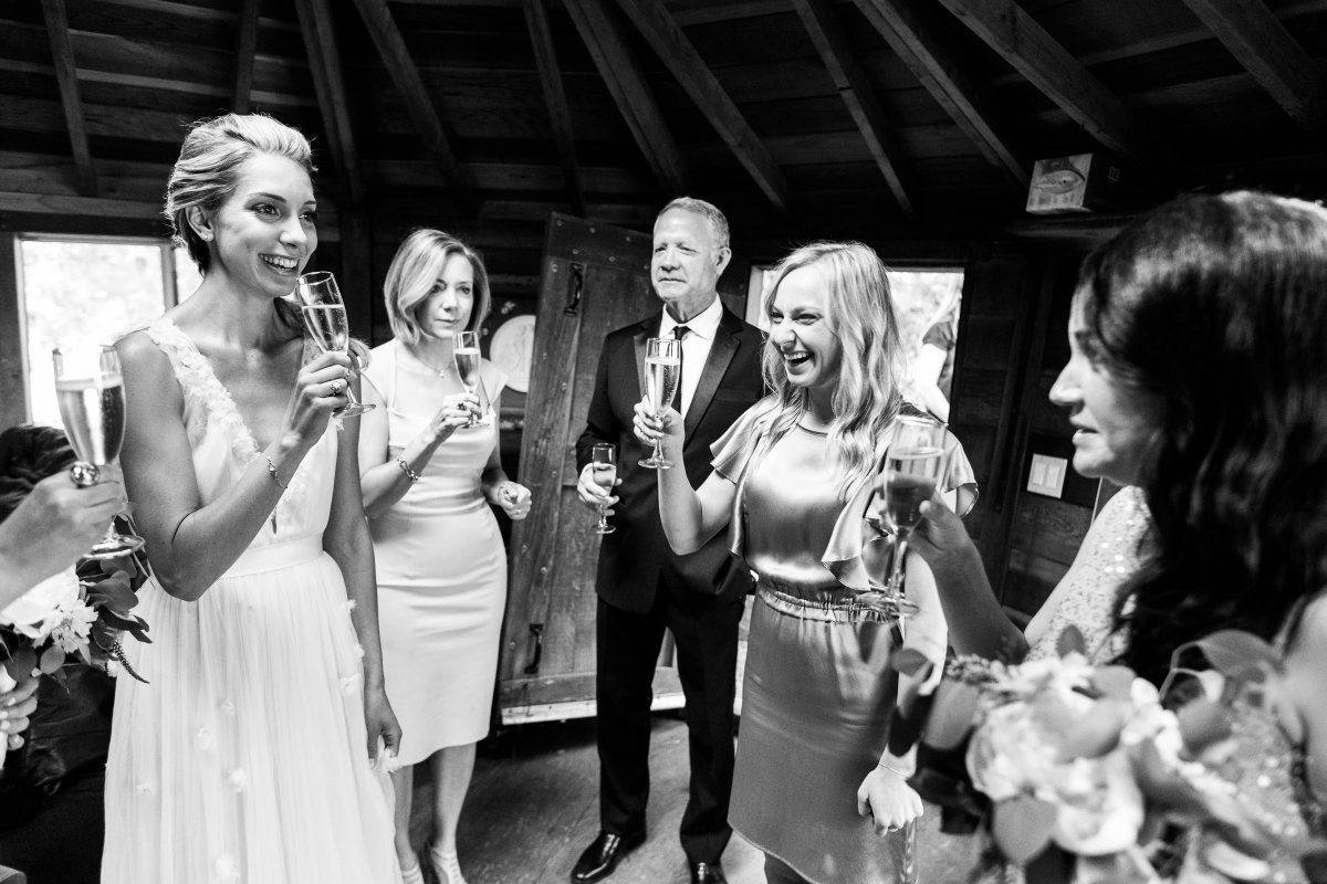 bridal party drinking champagne in a yurt