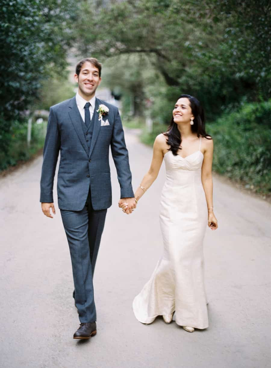 bride and groom walking and holding hands