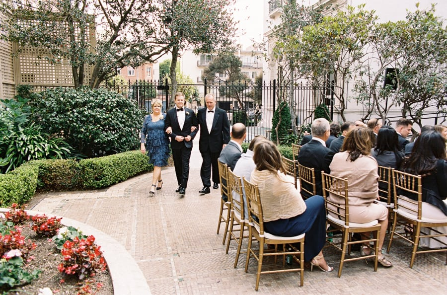 groom and parents enter ceremony