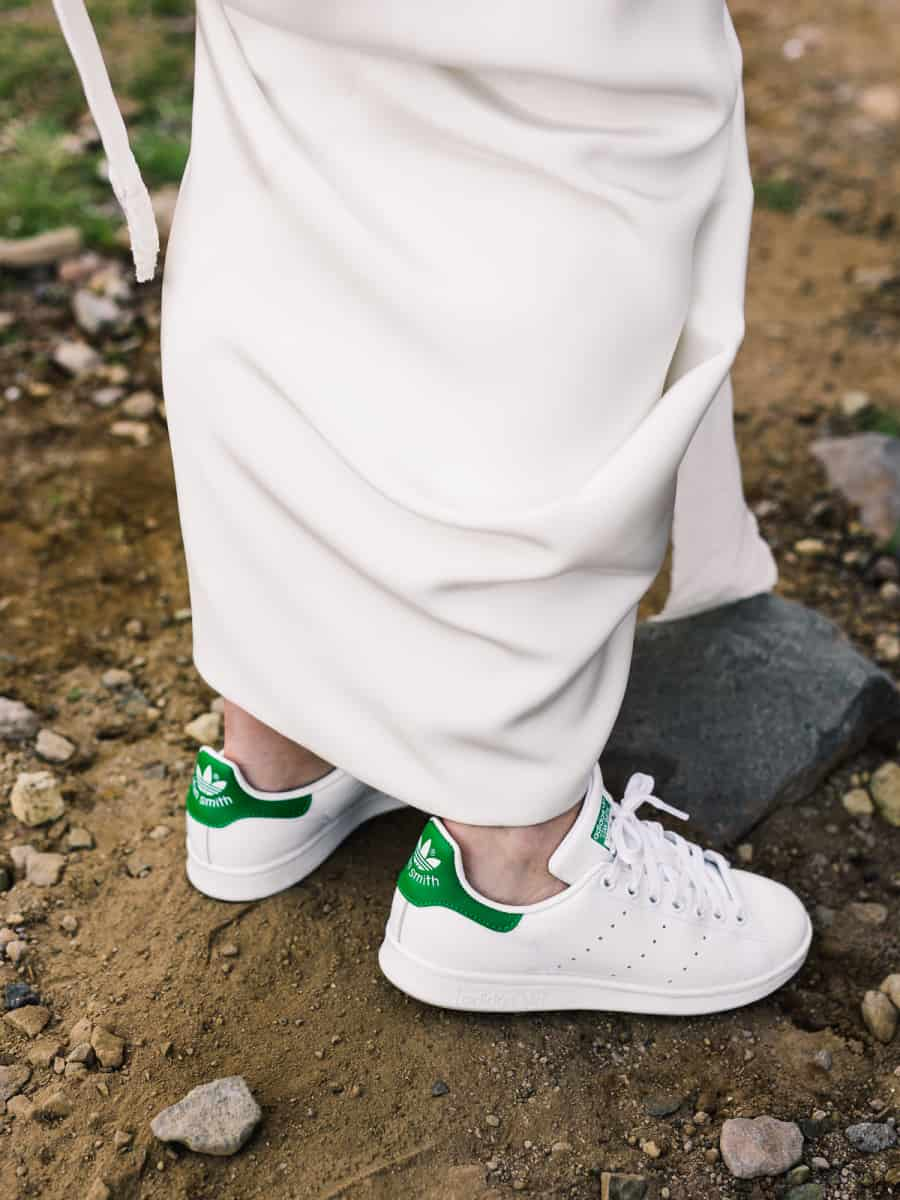 bride wearing white adidas stan smith shoes