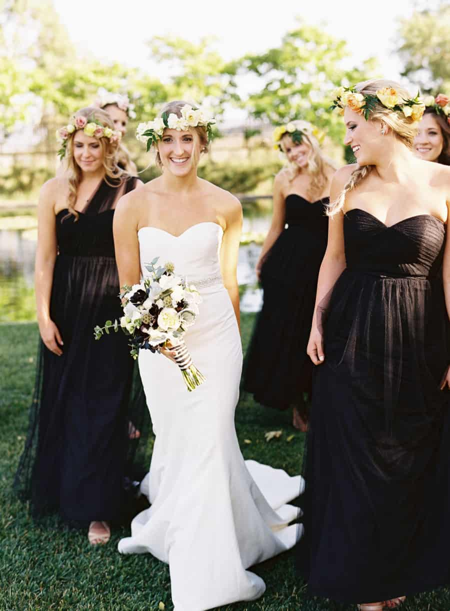 candid bride and bridesmaids laughing