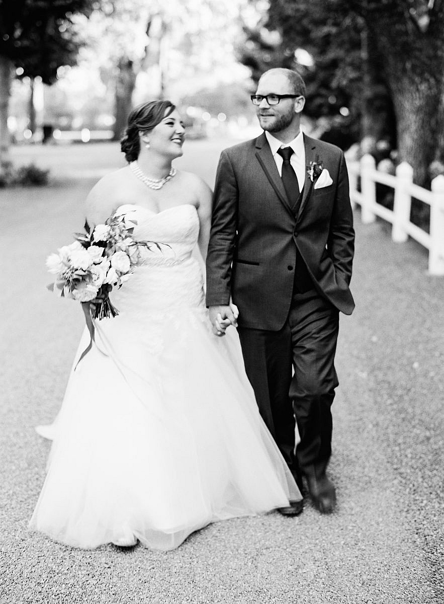 couples portrait walking in black and white