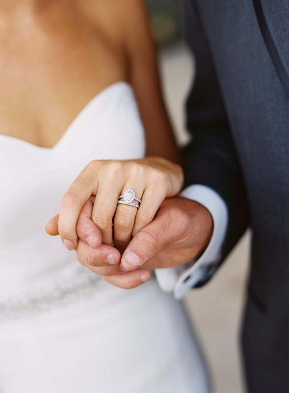 holding hands with rings