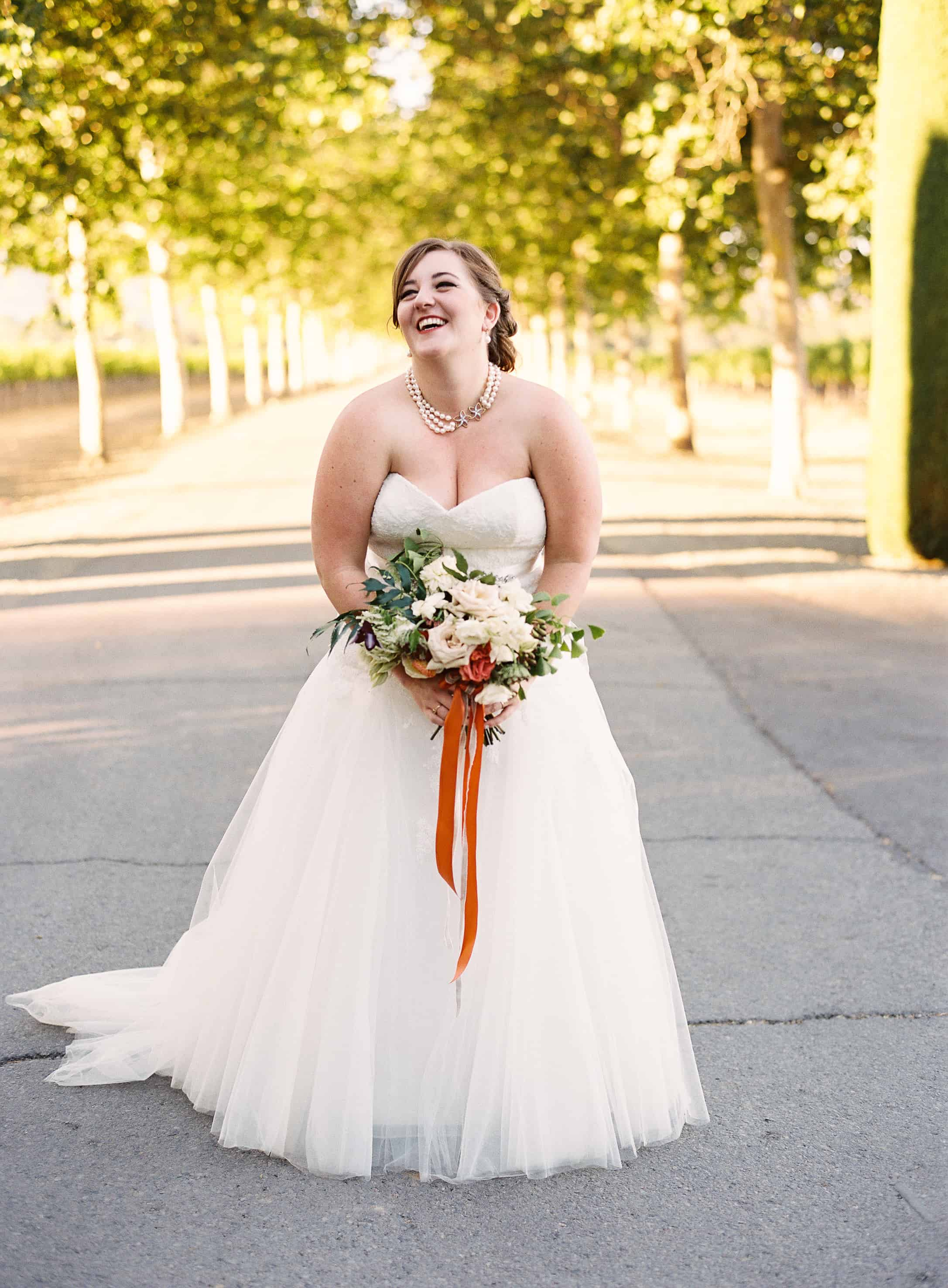 bride portrait laughing