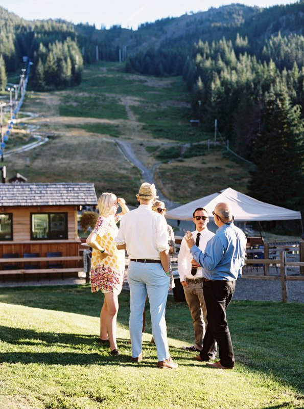 guests in front of summer ski slope