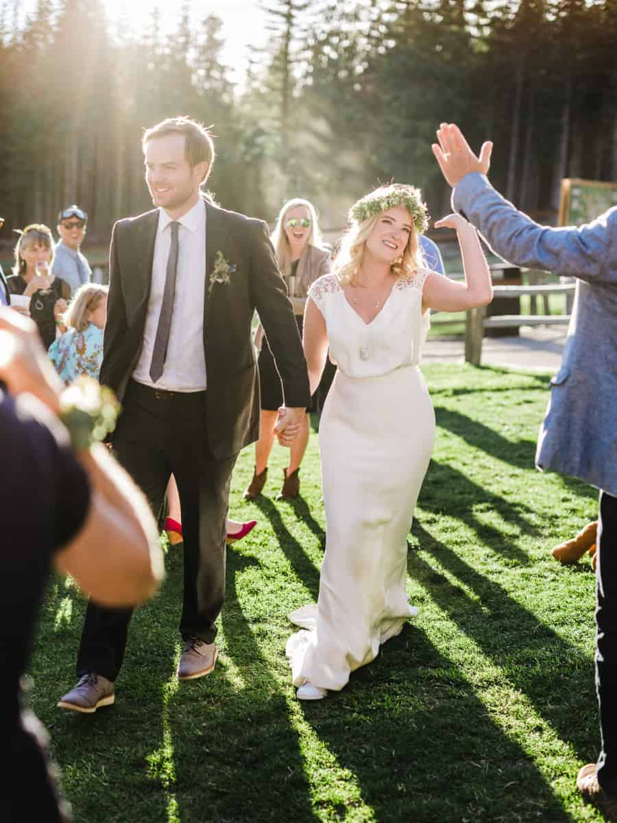 grand entrance bride giving high five
