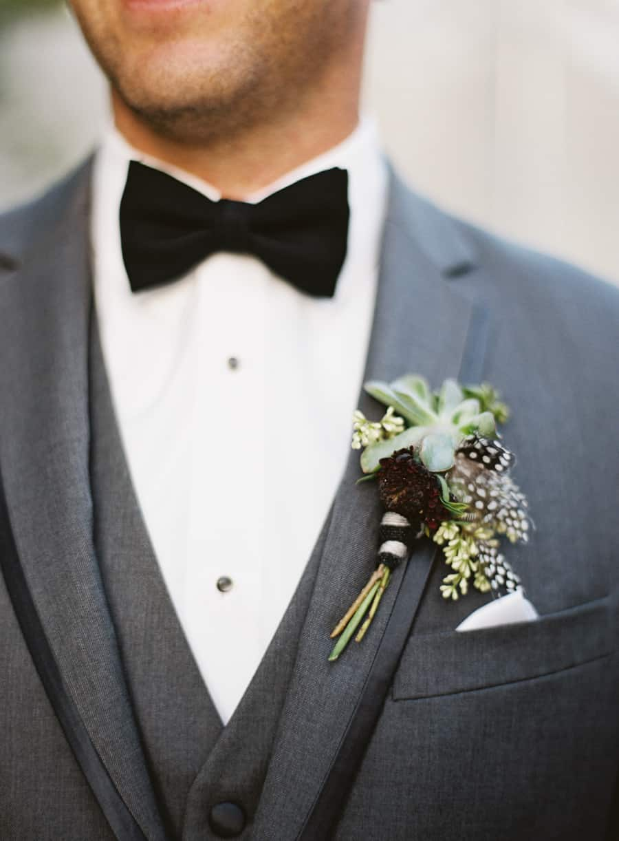 details groom boutonniere green succulent feathers