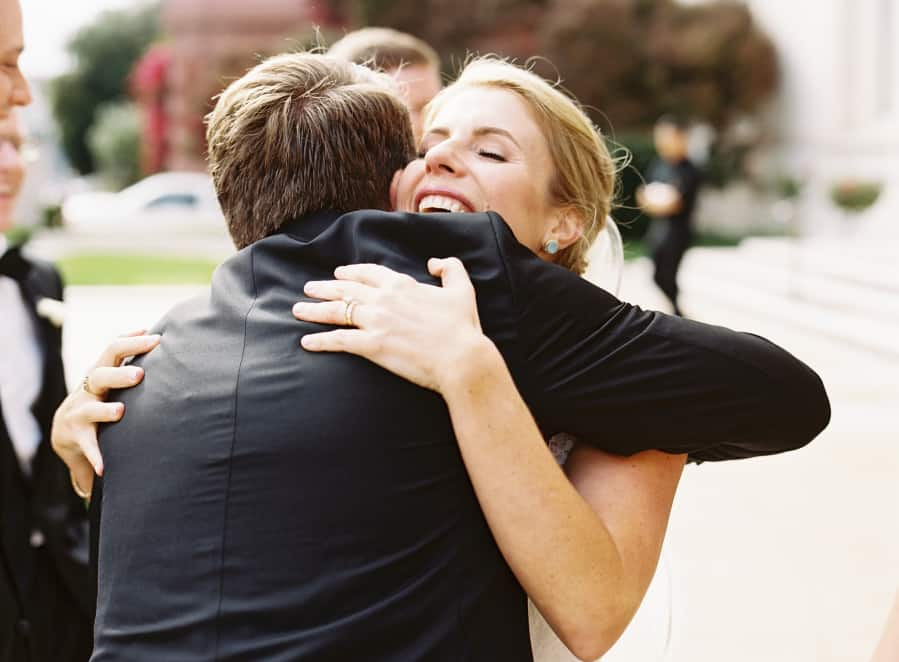 bride giving a hug