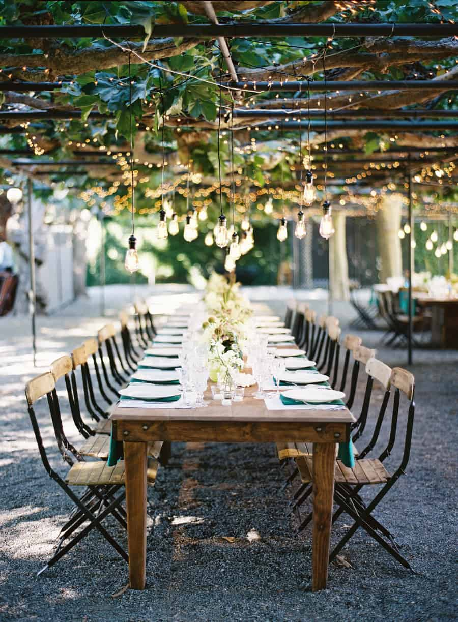 long rustic country dining table with folding chairs