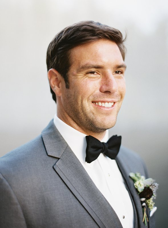 groom portrait black bow tie