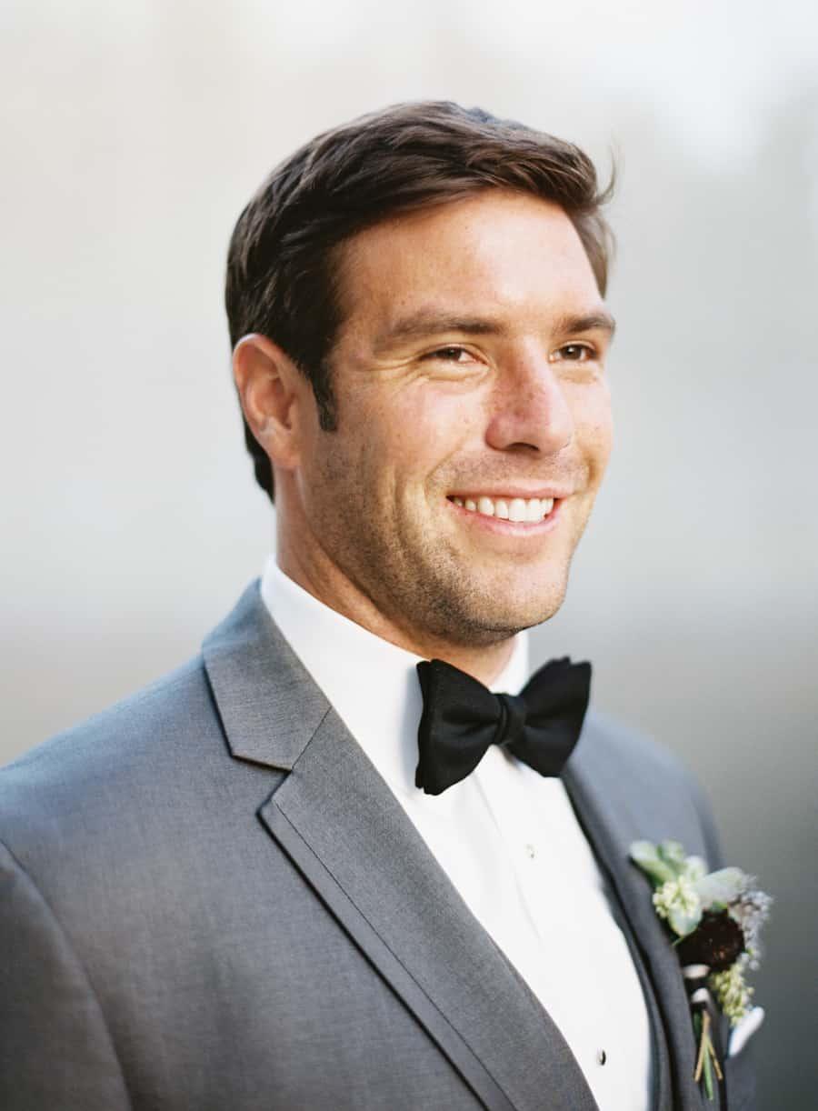 groom portrait black bow tie