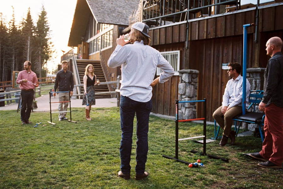 guests drinking and playing ladder toss