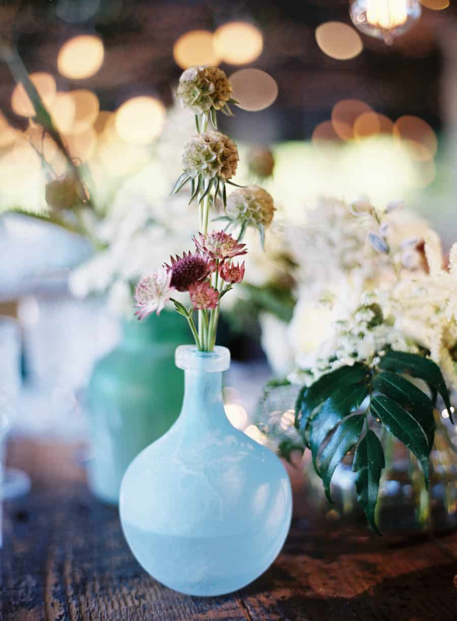 frosted blue vase with flowers