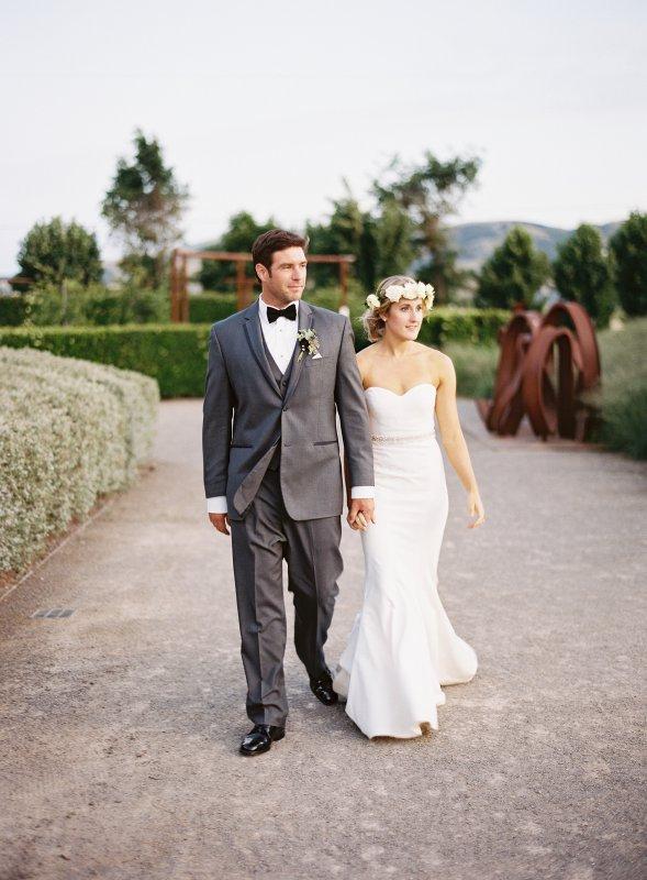 married couple walking in art garden