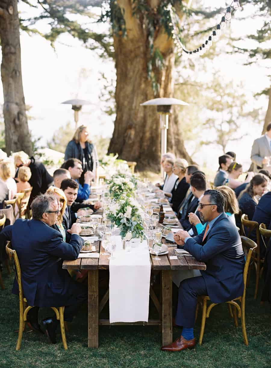 guests at long rustic dinner table