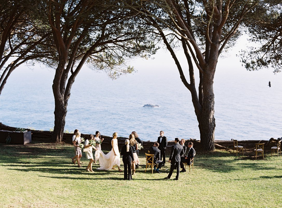 bridal party by the ocean