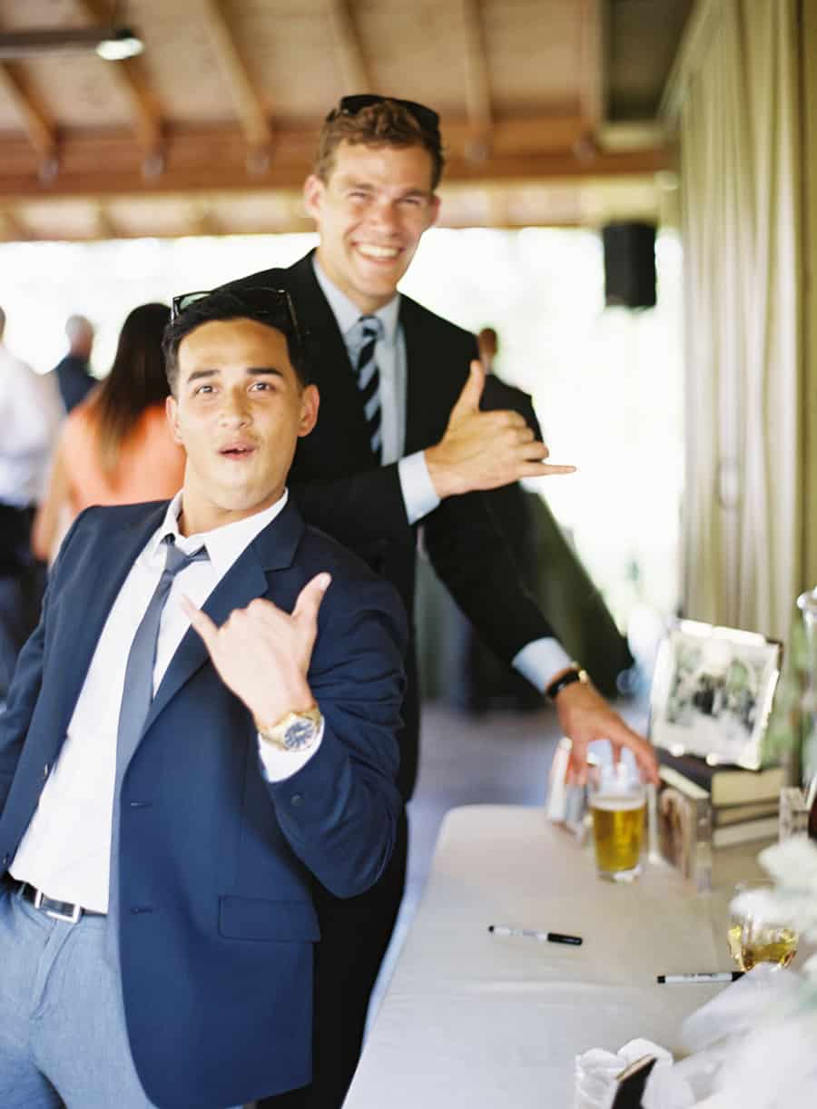 cocktail hour guests giving hang loose sign
