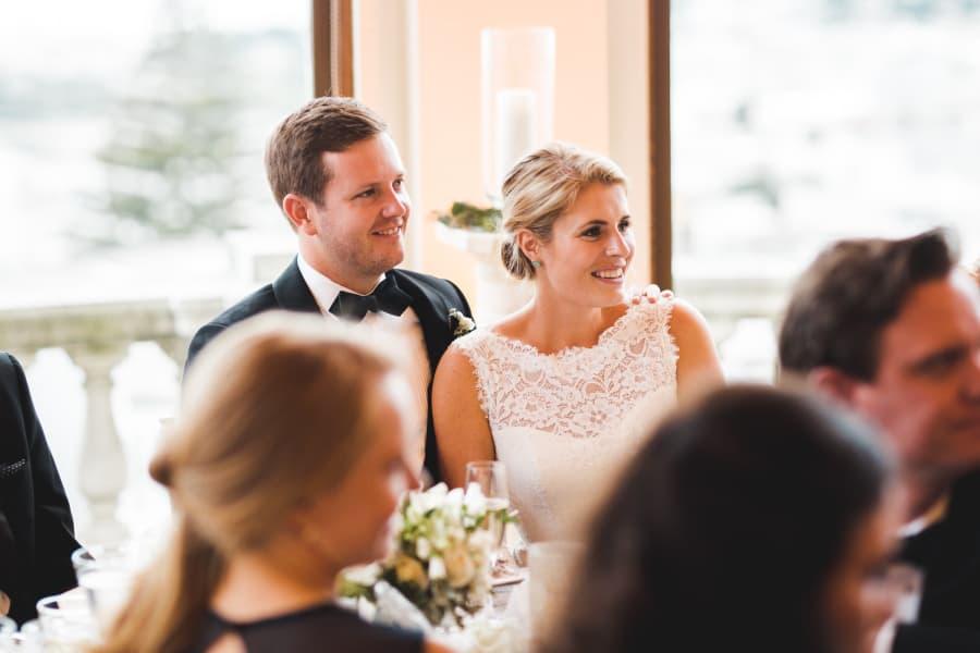 bride and groom listening to toast