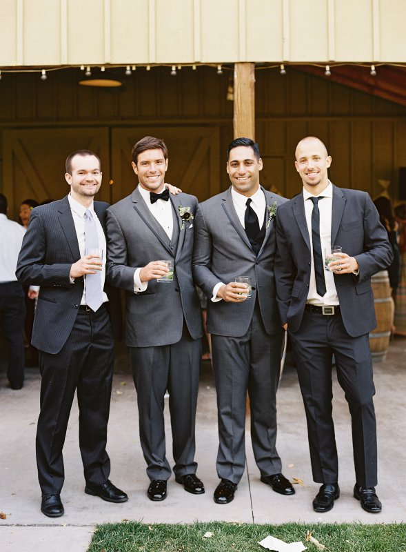 groom with guests and drinks