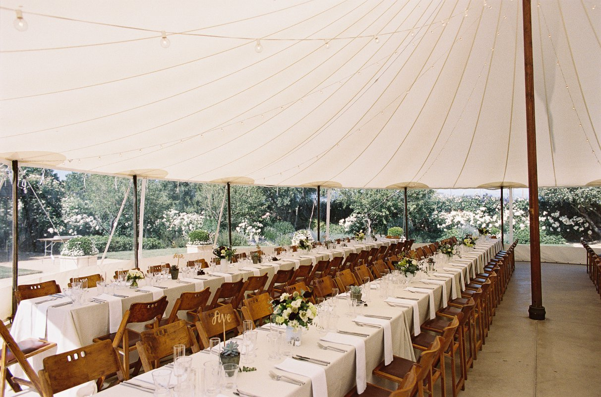 detail wedding dinner long tables in circus tent