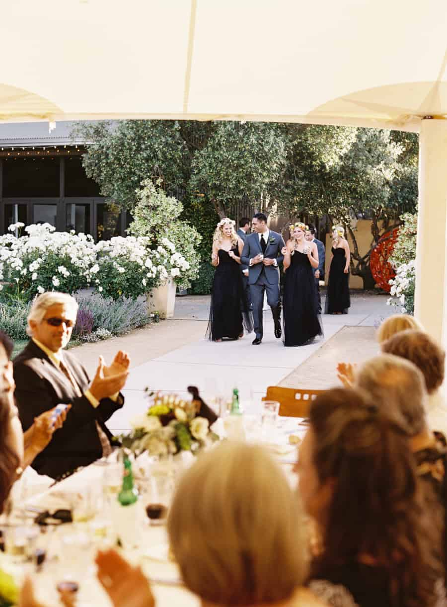 wedding party enters dinner