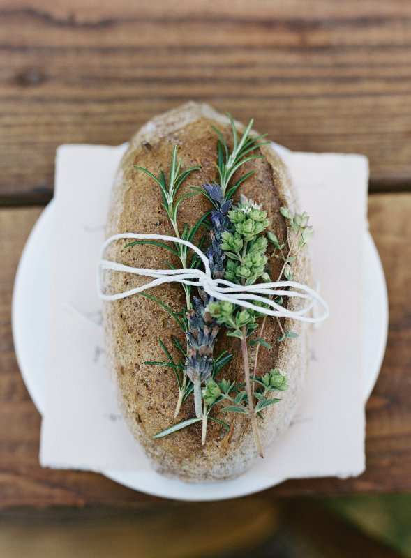 rustic bread loaf with herbs tied on top