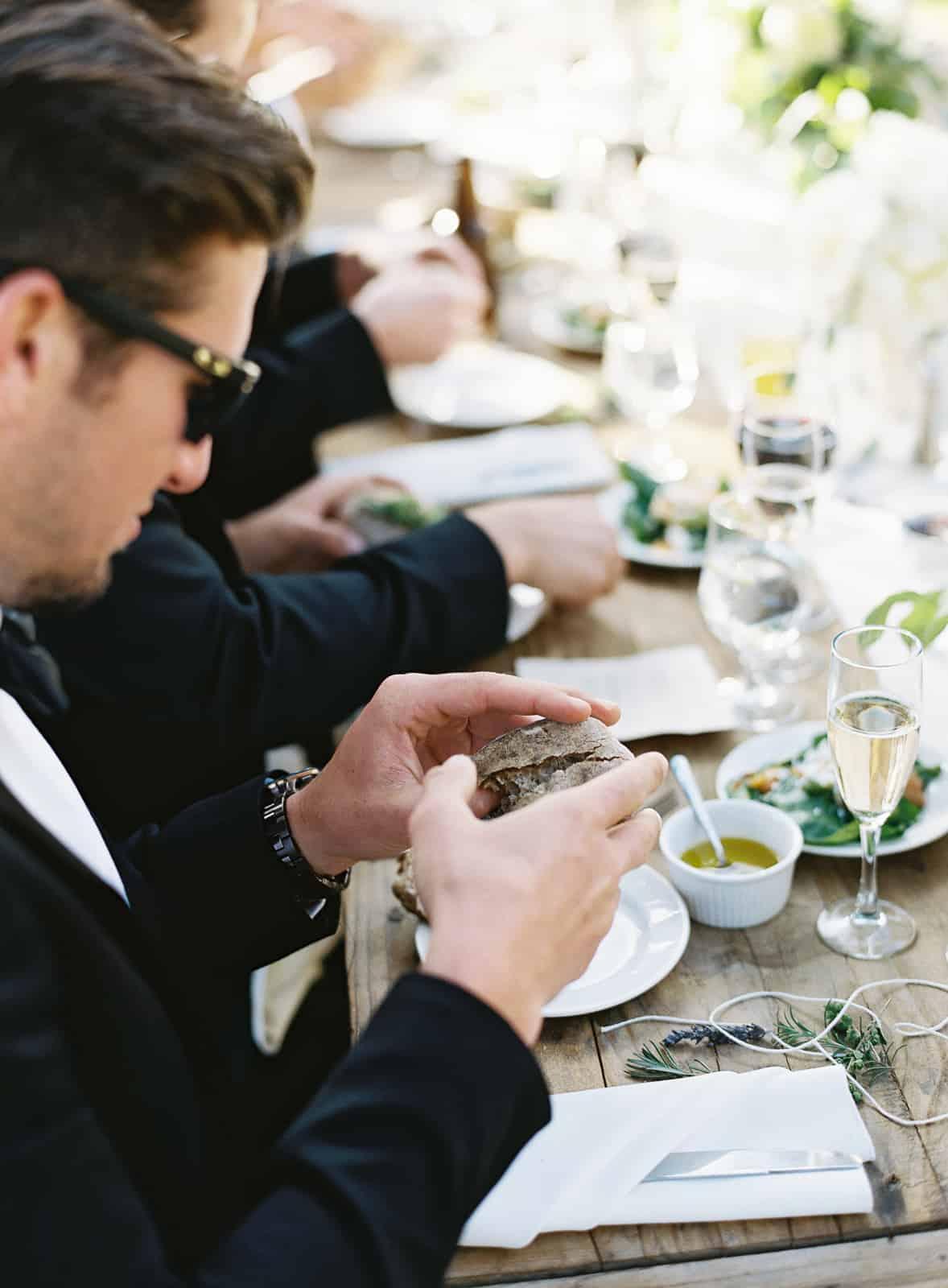guest breaking bread