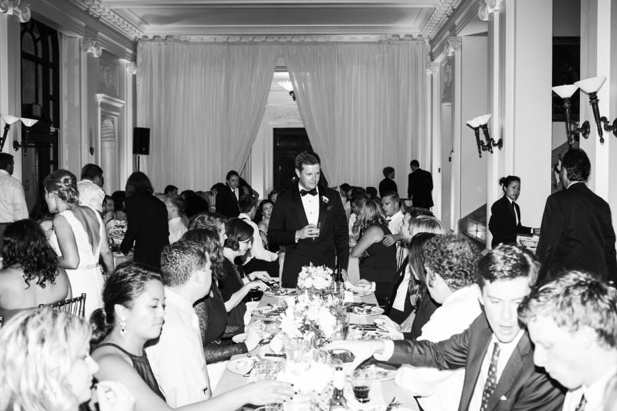 groom talking with guests while they eat
