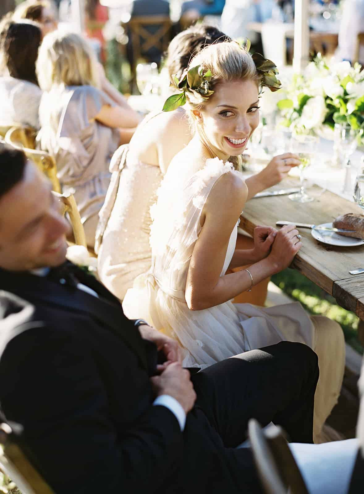bride and groom laughing at table