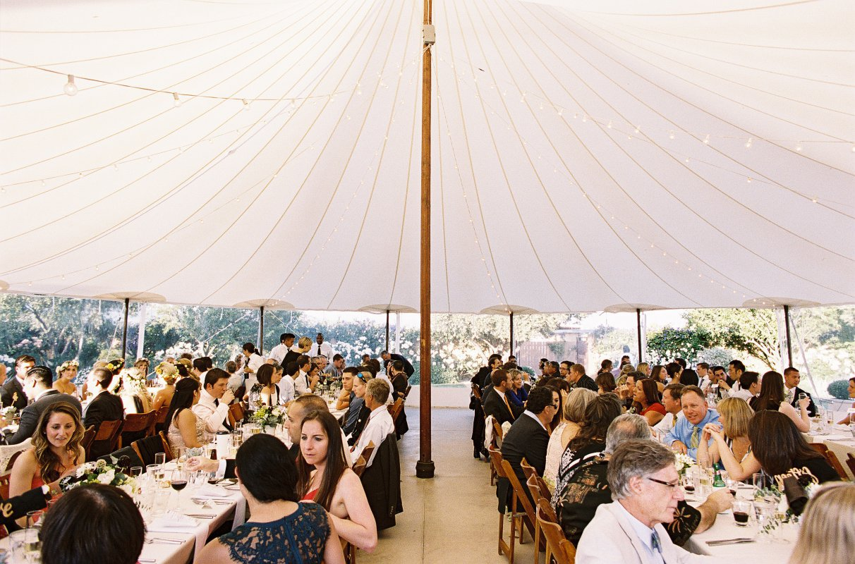 guests dining in a circus tent