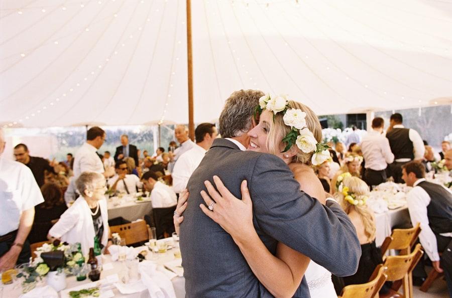 father hugging bride after speech