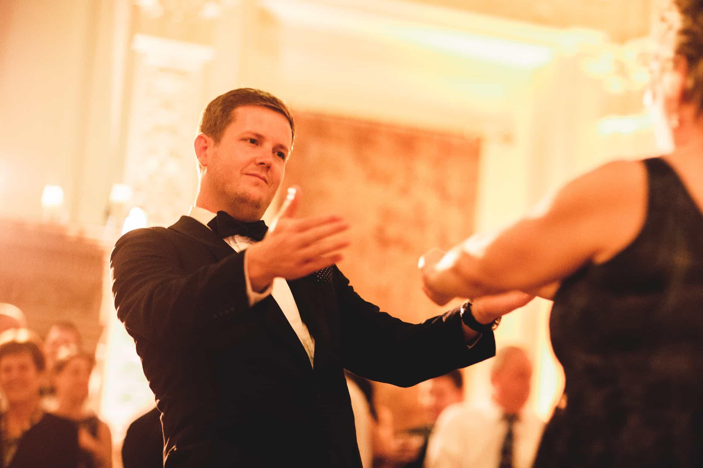 groom holding out arms