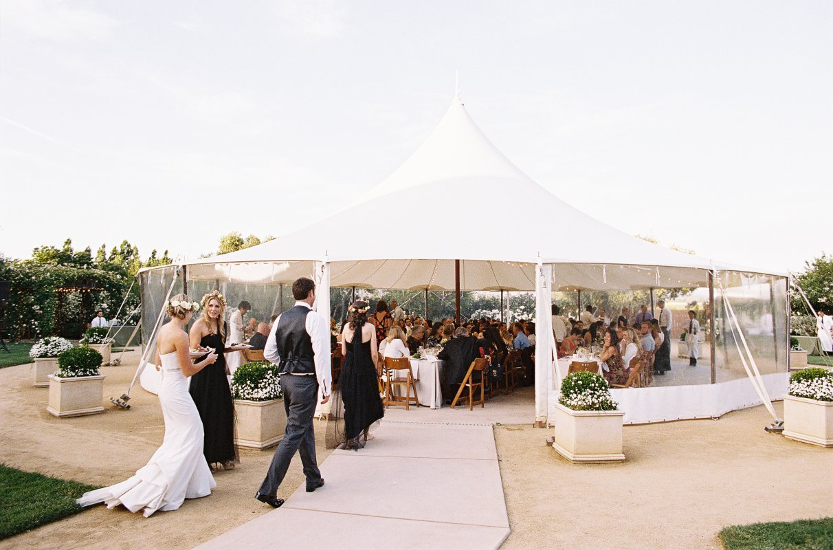white circus tent wedding dinner