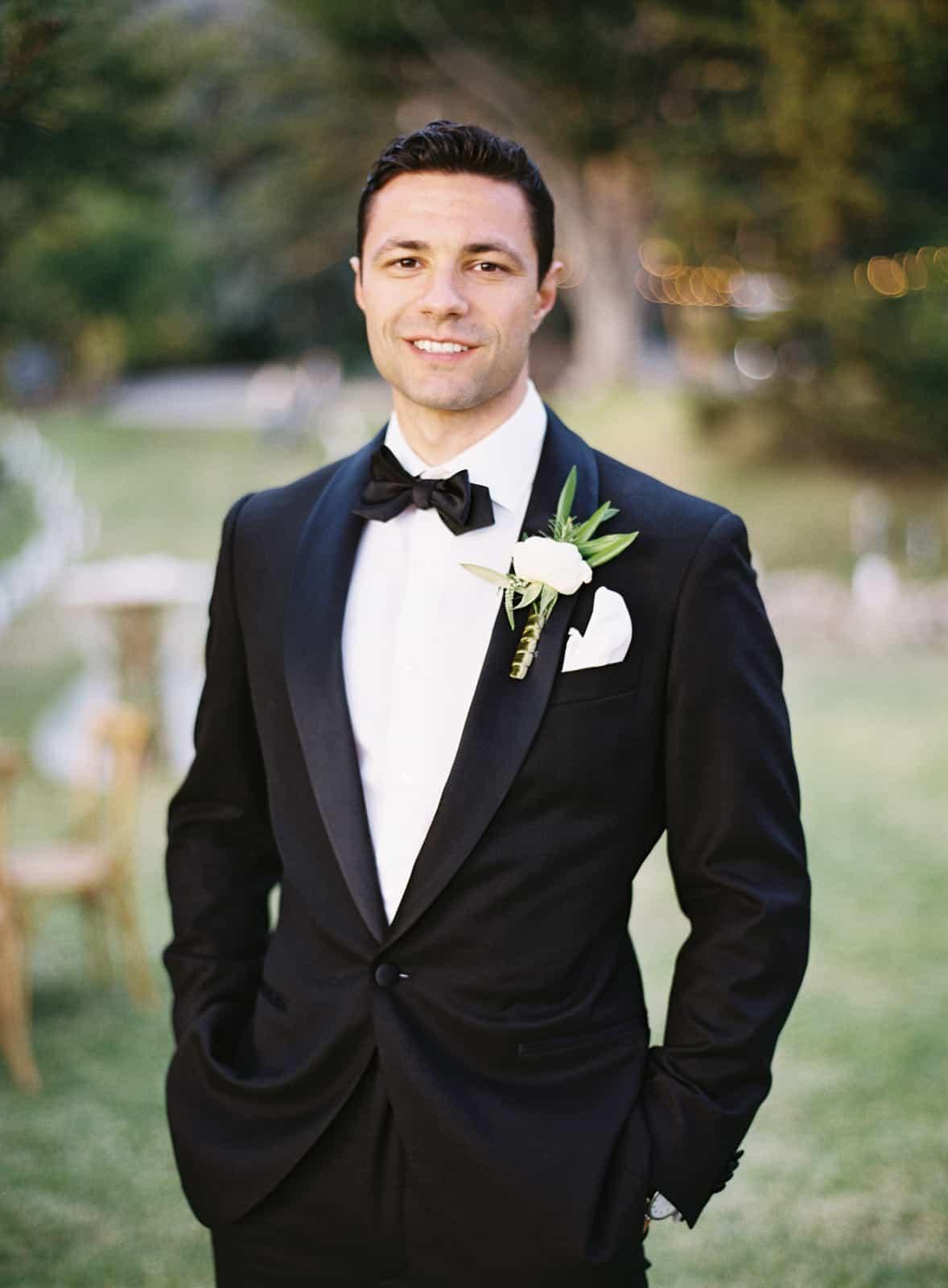 groom portrait in black tux