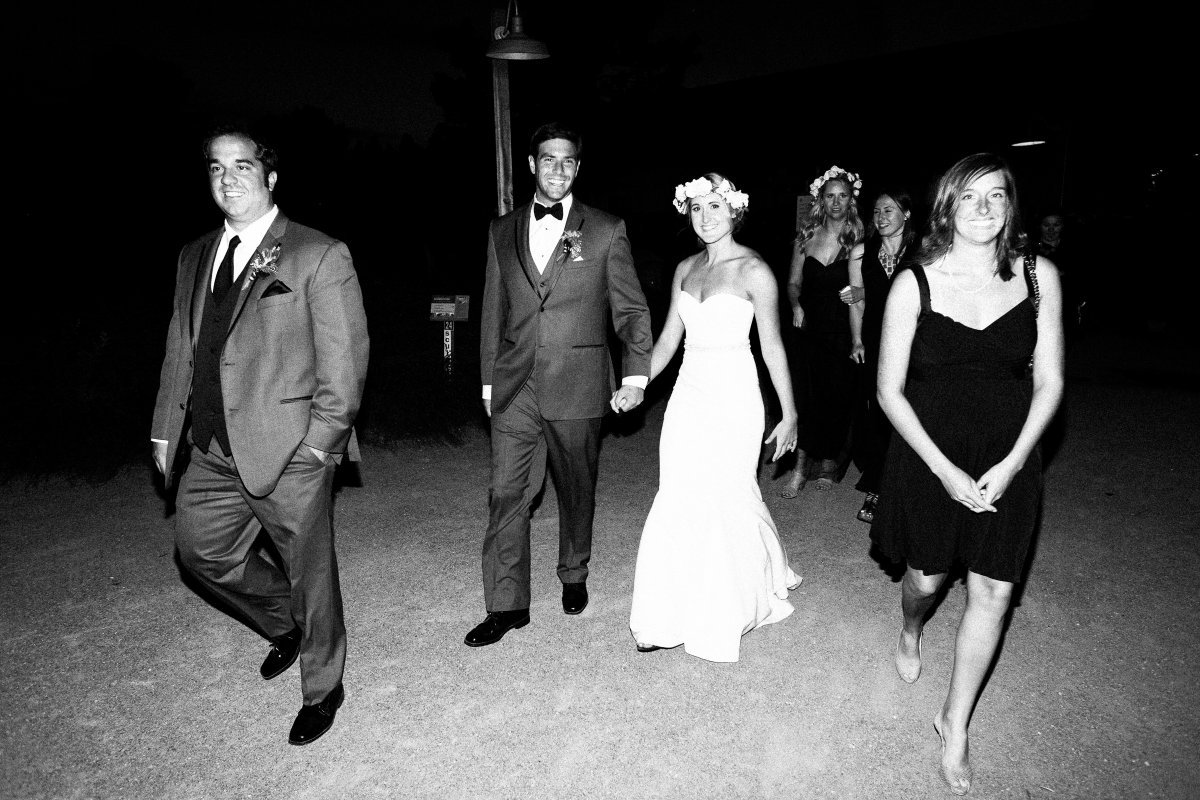 couple walking with guests