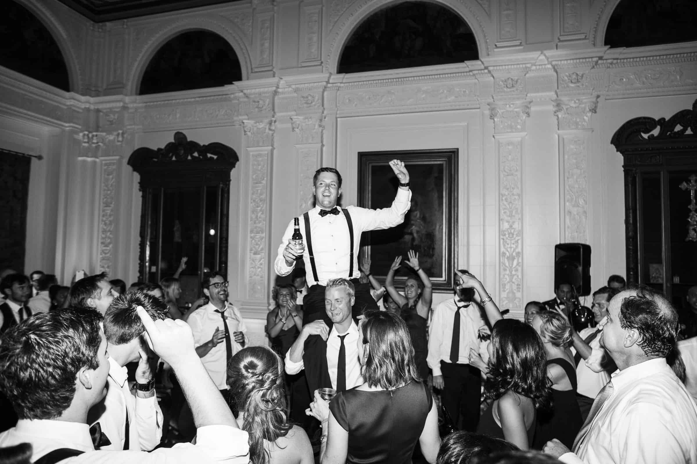 groom on shoulders
