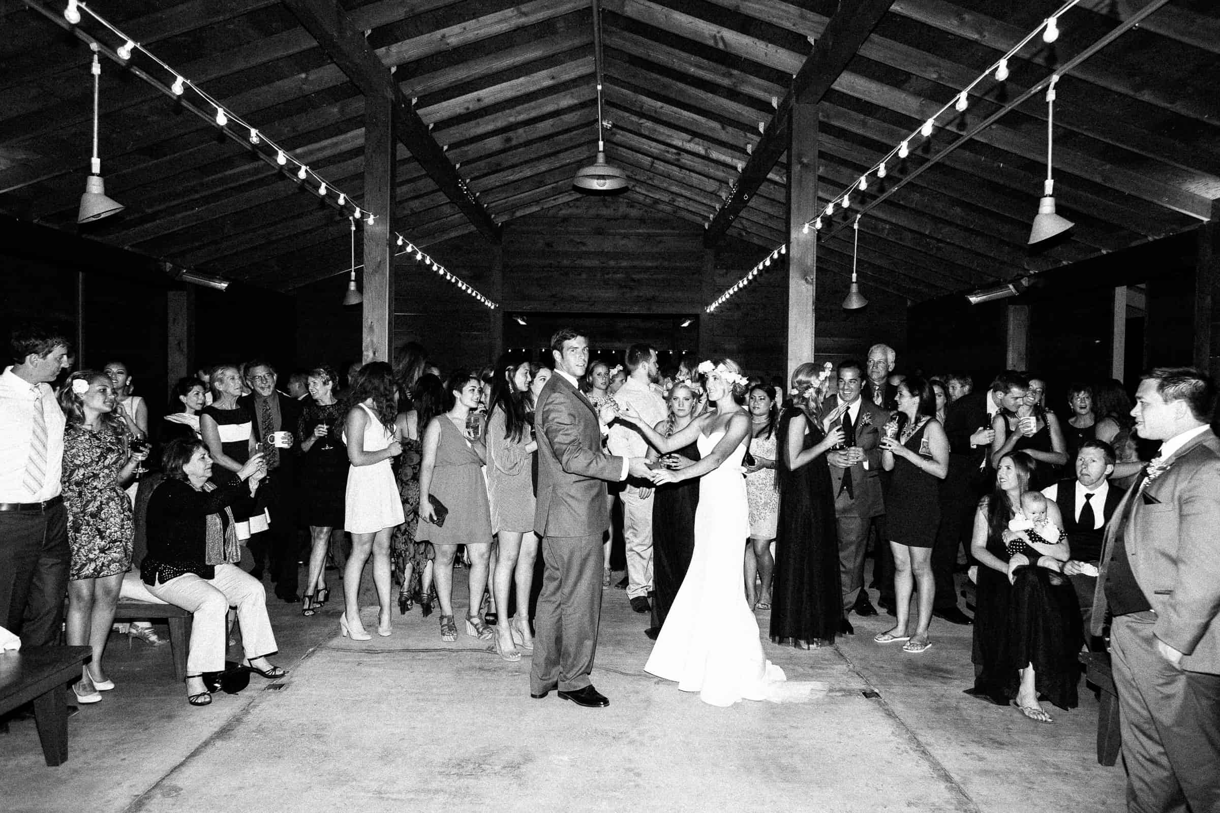 first dance surrounded by guests